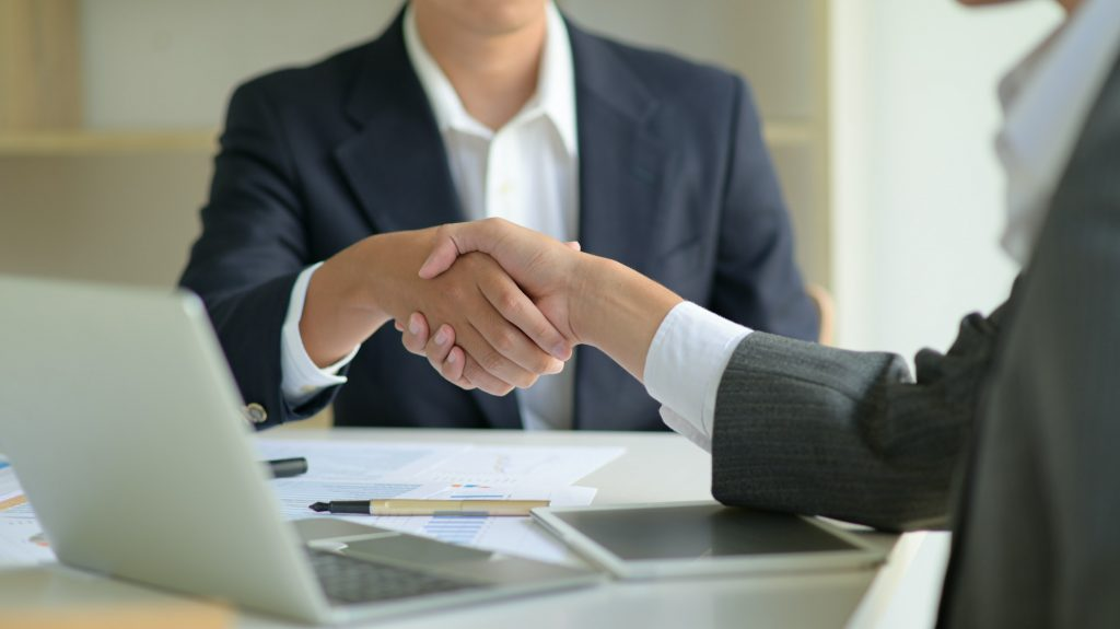 Business people shake hands to work.